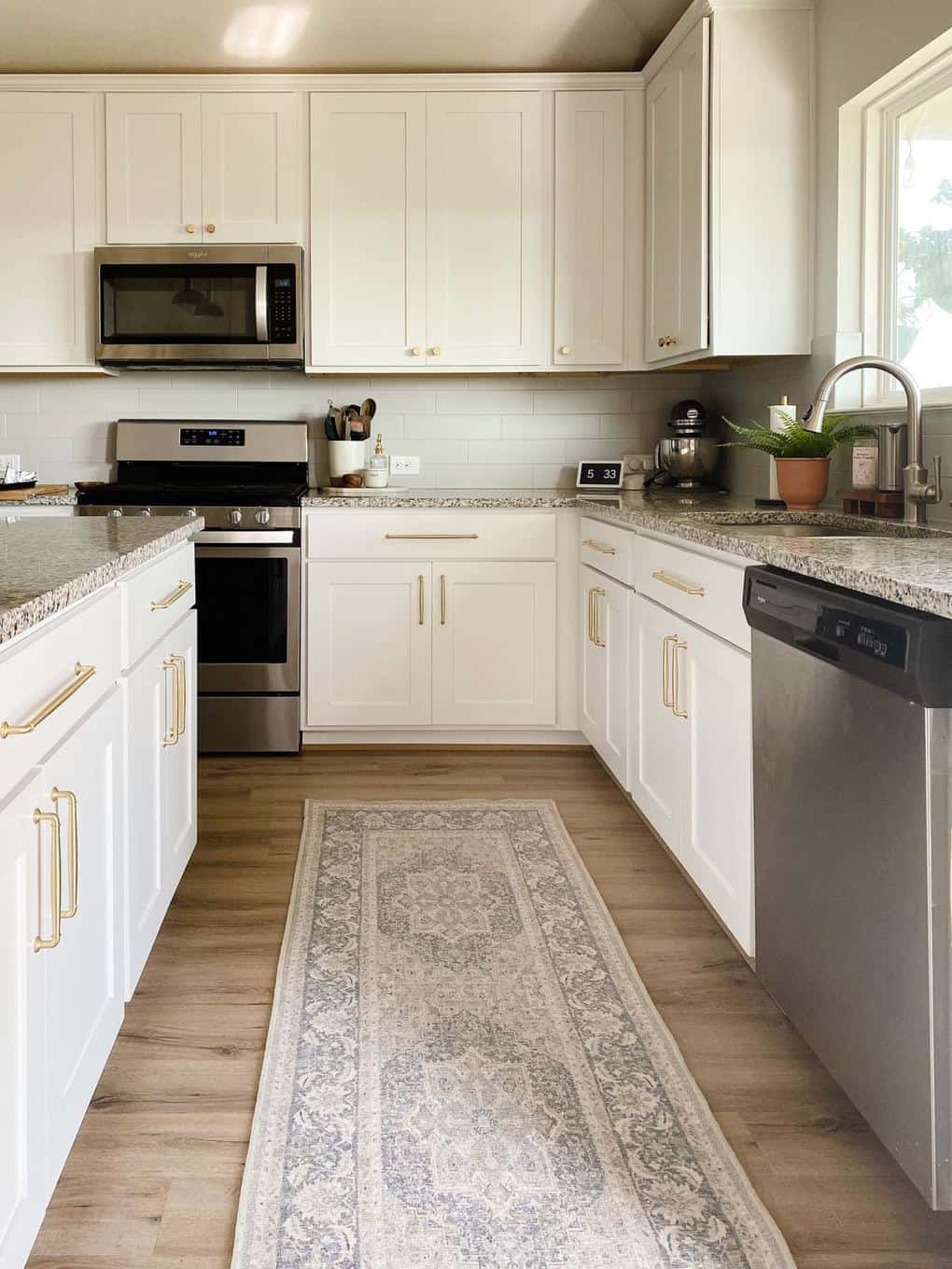 all-white kitchen with a vintage-style Ruggable runner