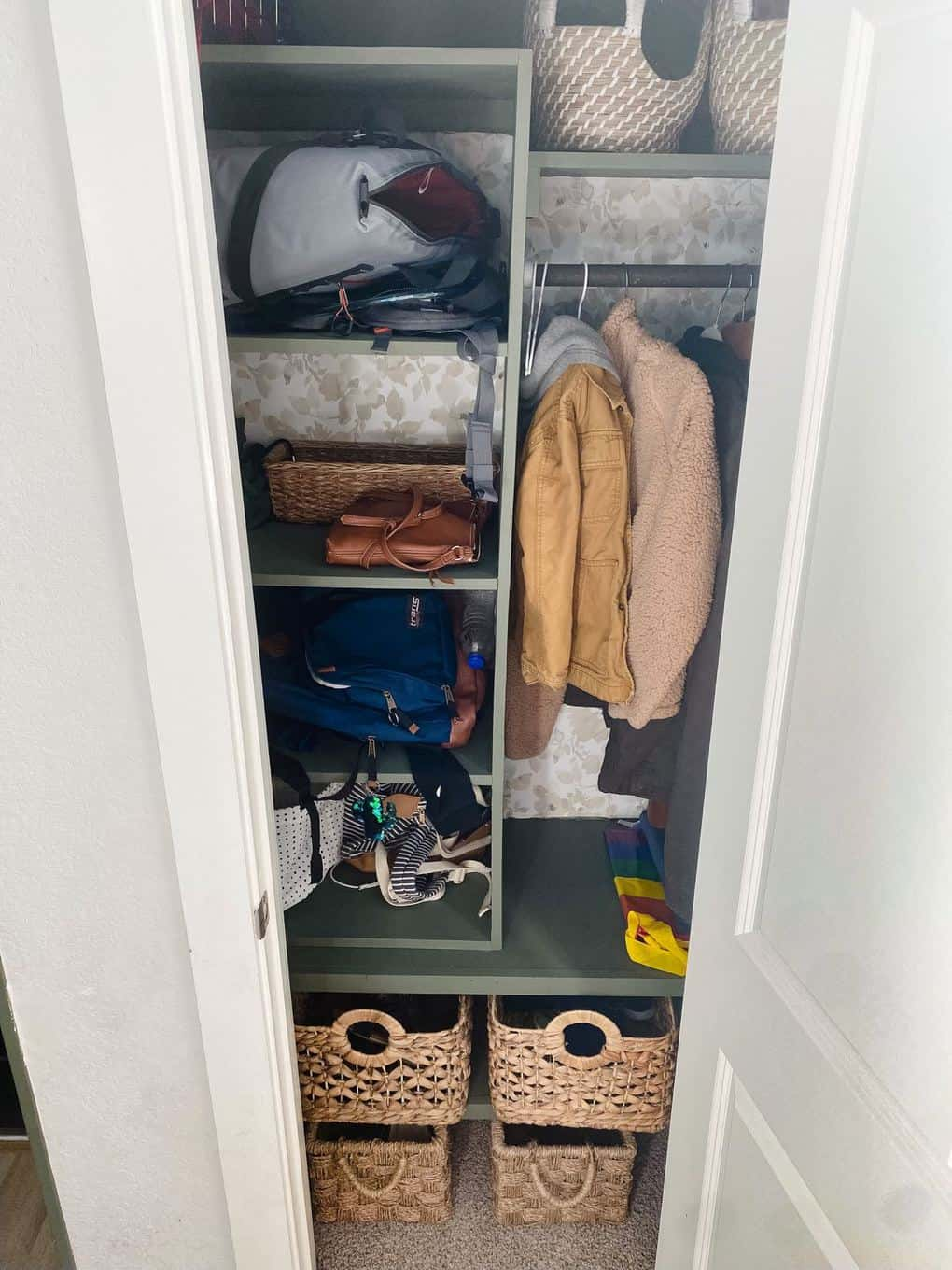 entry closet with built-in shelving