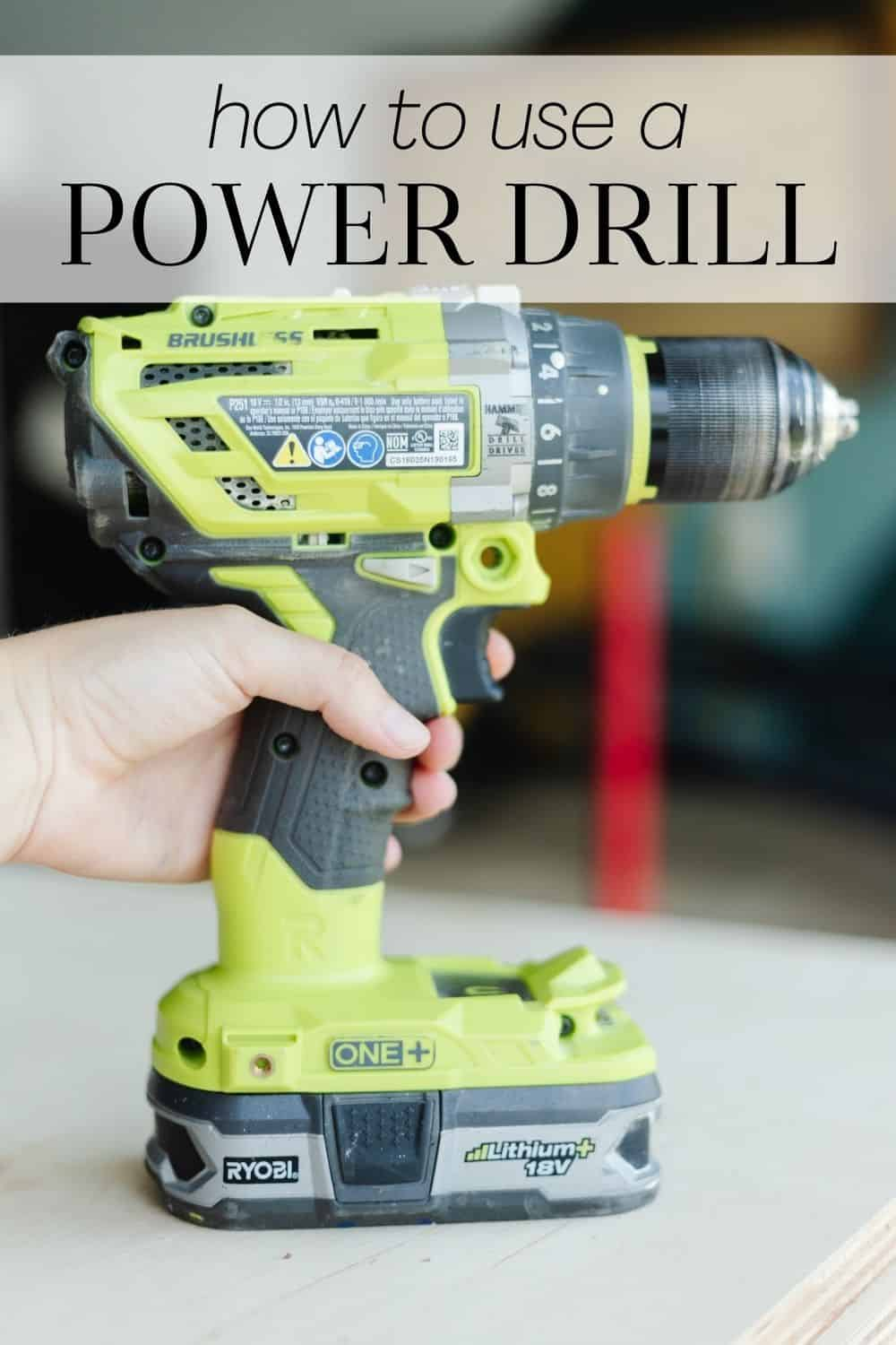 A close up of a Ryobi drill with a woman's hand holding it. The text overlay says