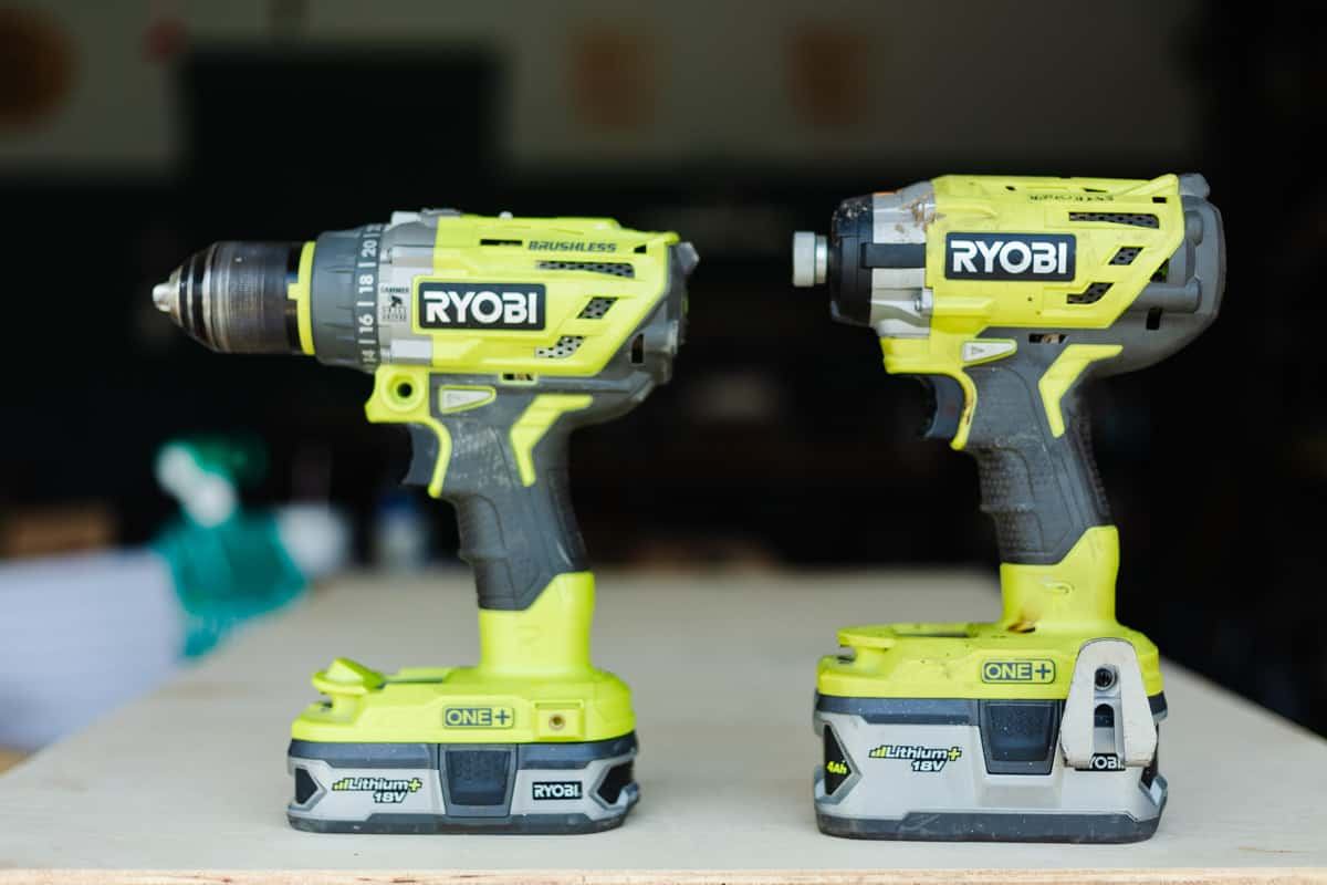 A Ryobi drill and impact driver sitting next to each other