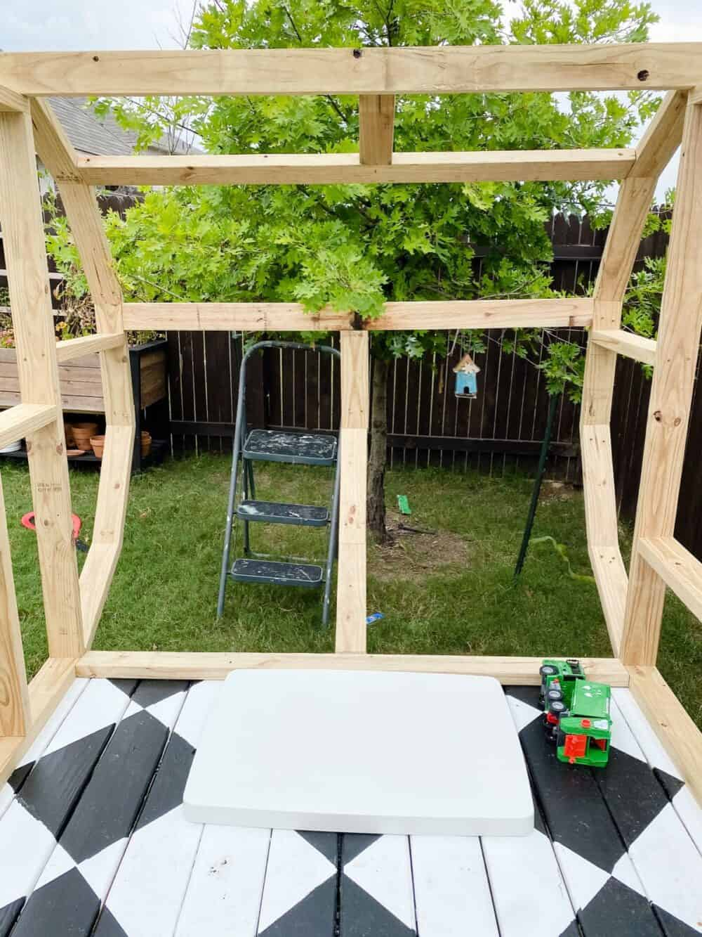Curved wall of DIY playhouse camper