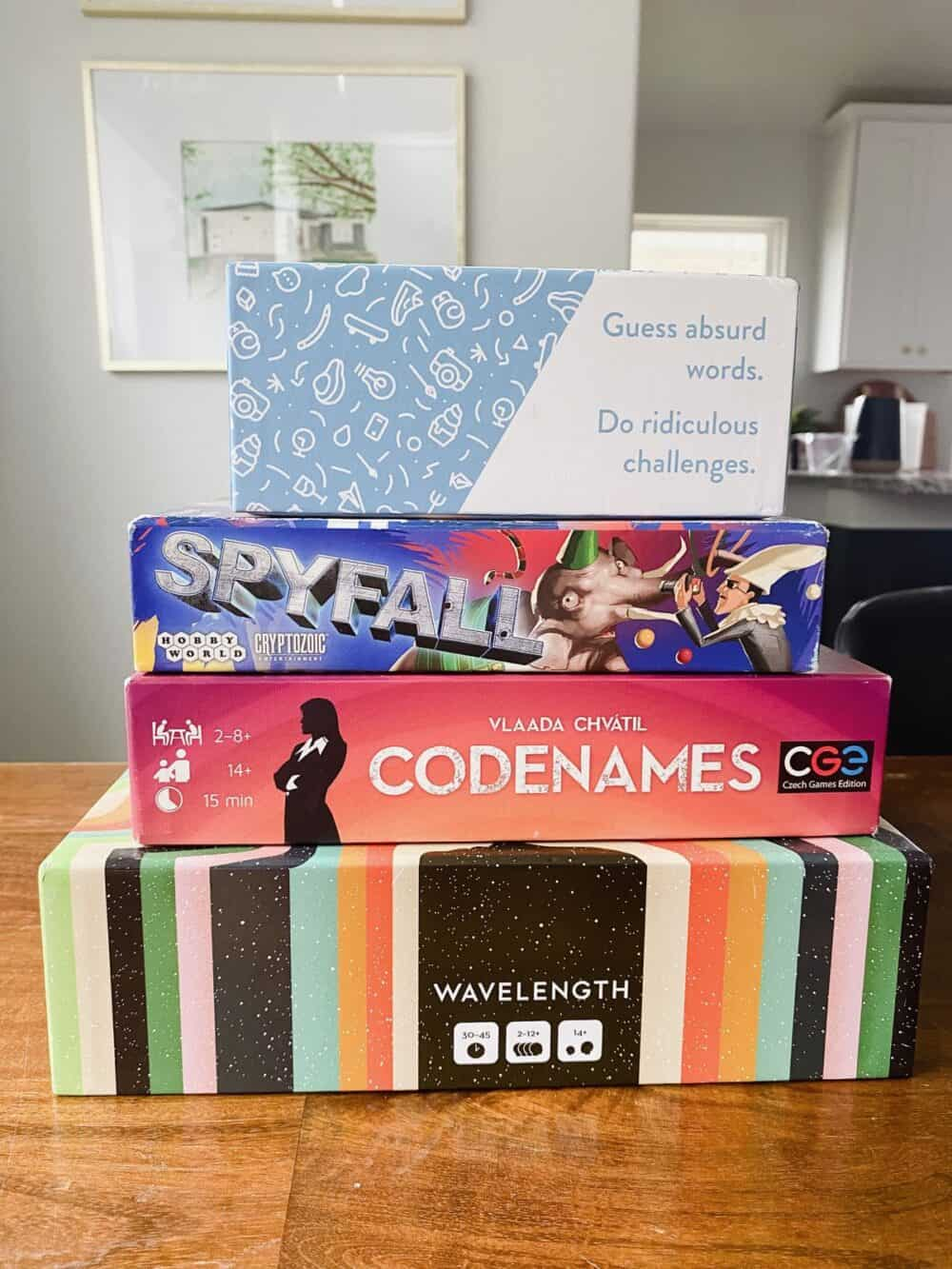Stack of board games, includes Wavelength, Codenames, Spyfall, and Rabble